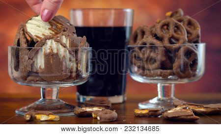 Sweet And Salty Chocolate Covered Salt And Vingear Potato Chips And Pretzels With Cola Drink, On Rus