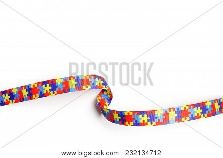 World Autism Awareness And Pride Day With Puzzle Pattern Ribbon On White Background
