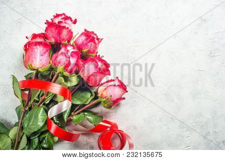 Red Rose Flower Bouquet On Stone  Table. Top View With Copy Space.
