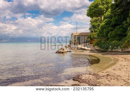 Corfu, Greece - May 14, 2016: Small House Overlooking Sea On Kalamaki Beach Near Kassiopi On Corfu I