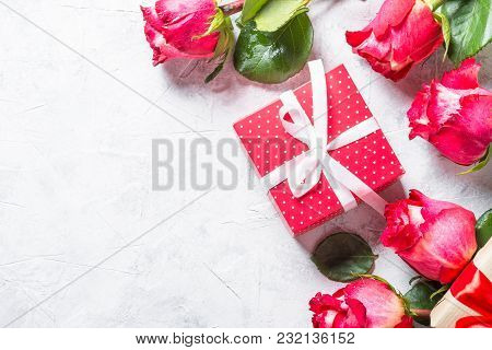 Red Rose Flower And Present Box On Stone  Table. Top View With Copy Space.