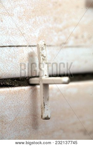 Laying Of Tiles Industrial Construction Worker Installing Small Ceramic Tiles On Bathroom Walls And
