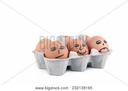 Close-up View Of Raw Chicken Eggs With A Smile In Box On White Background.