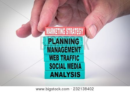 Marketing Strategy. Business Concept With Colorful Wooden Blocks.