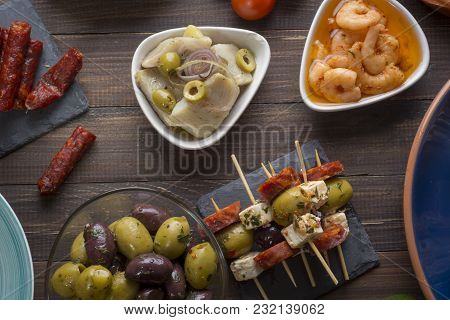 Mixed Tapas Starters Food On Table. Open Sandwiches, Shrimps, Olives. Top View