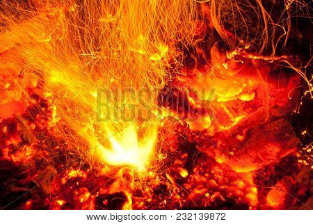 Fire Flames With Long Exposure Of Sparks