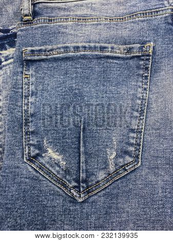 Blue jeans back pocket texture background with blank space