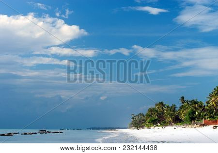 Tropical Beach At Low Tide. Fishing Boats By The Shore.