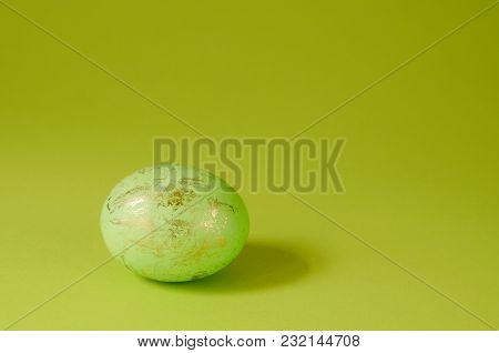 Minimalist Concept Template With One Easter Egg On A Green Background