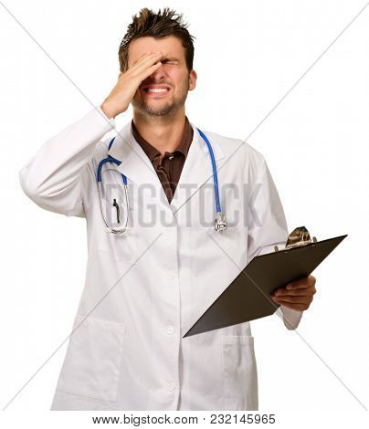 Portrait Of Young Frustrated Doctor On White Background