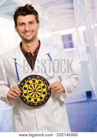Happy Young Doctor Holding Bulls Eye, Indoor