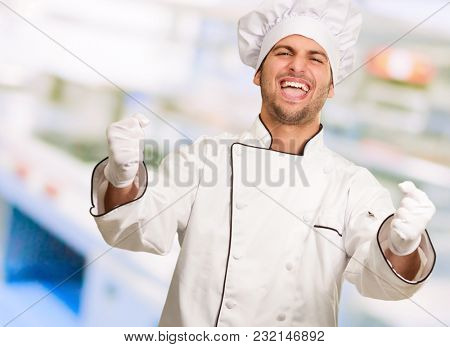 Portrait Of Happy Male Chef, Indoors