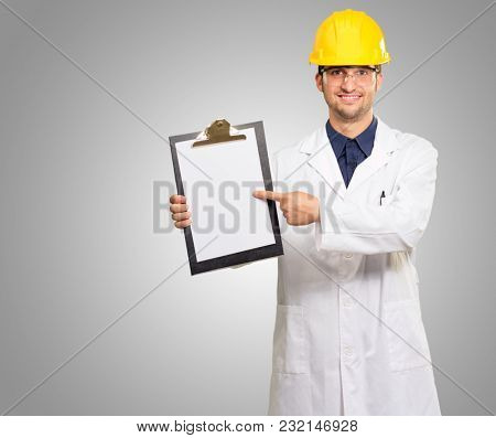 Architect Pointing On Clipboard On Grey Background