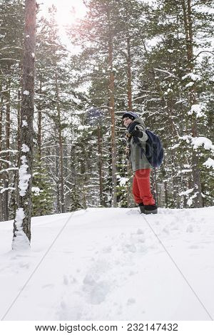 Cute, Smiling Woman Climbed Up The Hill Through The Snowdrifts In The Snowy Winter Forest And Called