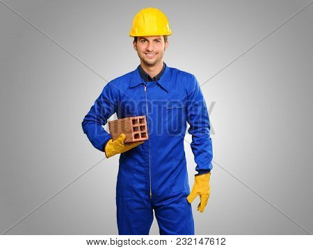 Happy Engineer Holding Brick Isolated On Grey Background