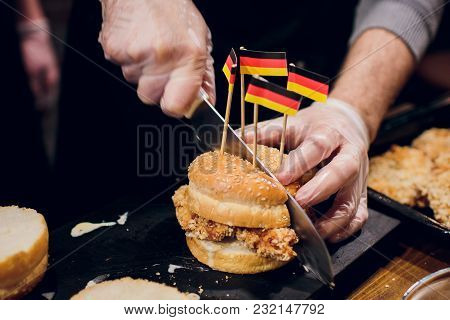 Chief Cook Preparing Fresh Burger In The Kitchen.burger Restaurant Menu Cooking Process. The Cook Cu
