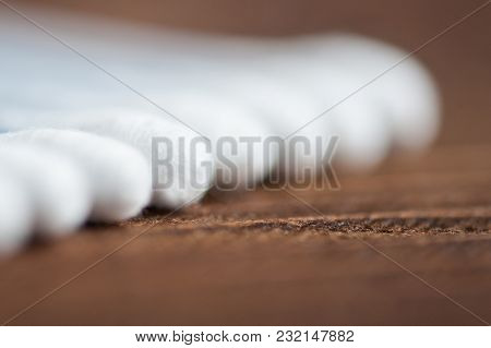 Ear Wand Of White Cotton Buds Or Cotton Swab On Wooden Background.