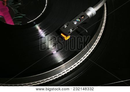 Closeup Of Vinyl Turntable, Hi-fi Headshell Cartridge In Action, Retro Gramophone Playing Analog Dis