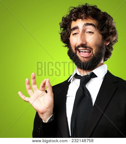 Portrait Of A Funny Businessman against a green background