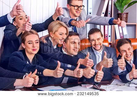 Business people office life of team people happy sitting table. People in business suits are happy from successful deal and wish success to everyone around them. Modern methods of doing business.