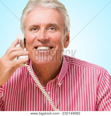 Happy Man Talking On Telephone against a blue background