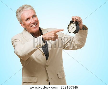 Man Pointing At An Alarm Clock against a blue background