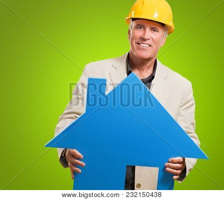 Architect Man Holding House Model against a green background