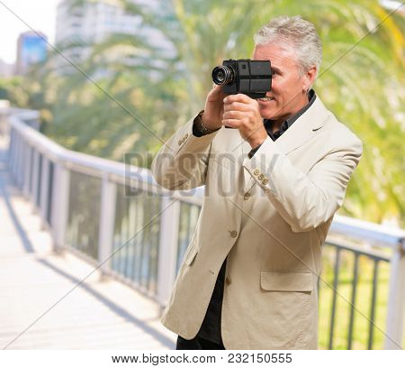 Man Holding Camcorder, outdoor