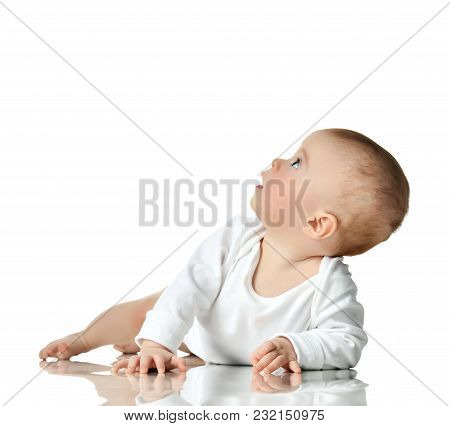 7 Month Infant Child Baby Girl Toddler Lying In White Shirt Looking Up Isolated On A White Backgroun