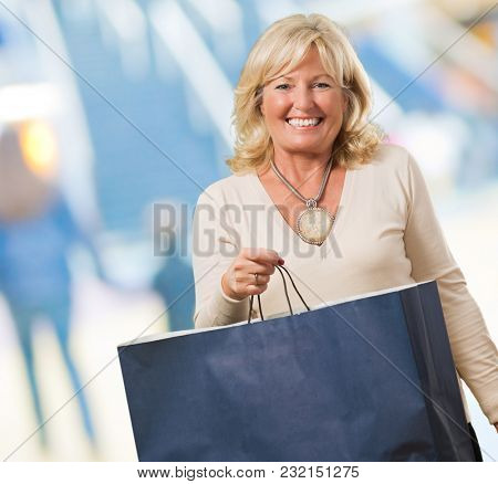 Mature Woman With Shopping Bag, indoor