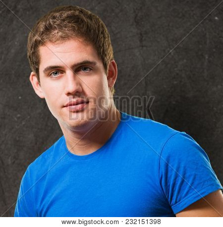 Serious young man against a grunge background