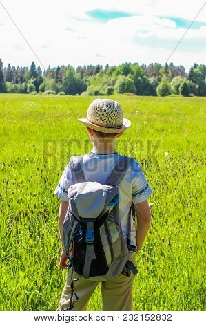 Traveller Boy With Backpack In The Field