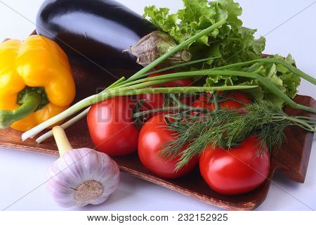 Fresh Assorted Vegetables, Eggplant, Bell Pepper, Tomato, Garlic With Leaf Lettuce. Isolated On Whit