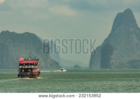 View Of Boats And The Islands Of The Phang Nga Bay With Its High-altitude Mountains Cut On The Knife