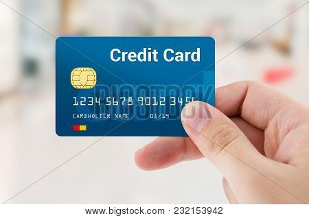 Man Hand Holding Personal Credit Or Debit Card