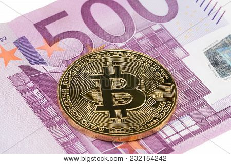Golden Bitcoin Close-up On Euro Currency Background. High Resolution Photo.