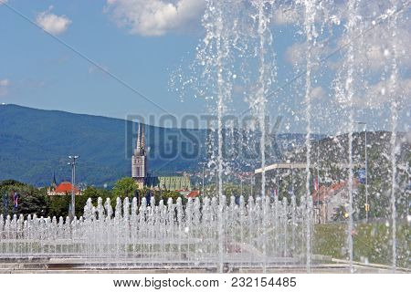 View Of Zagreb Cathedral Behind The Water Curtain