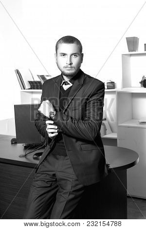 Serious Young Man In A Suit In An Office.