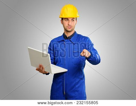 Engineer Holding Laptop Isolated On Grey Background