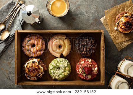 Variety Of Colorful Old Fashioned Fried Gourmet Donuts In A Wooden Box With Glaze