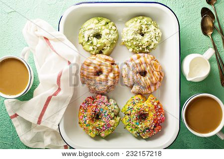 Variety Of Colorful Old Fashioned Fried Gourmet Donuts With Glaze On A Tray