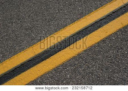 Matching Yellow Lines On Asphalt Road