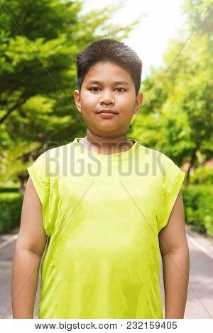 Portrait Handsome Asian Sport Boy In Garden.
