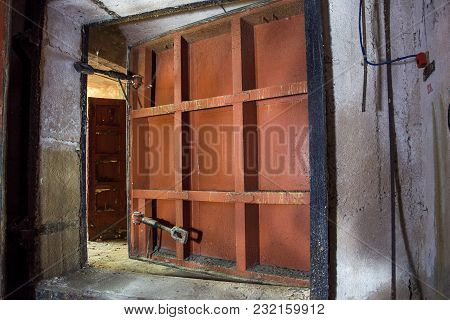 Big Rusty Heavy Steel Hermetic Doors In The Abandoned Soviet Bomb Shelter.