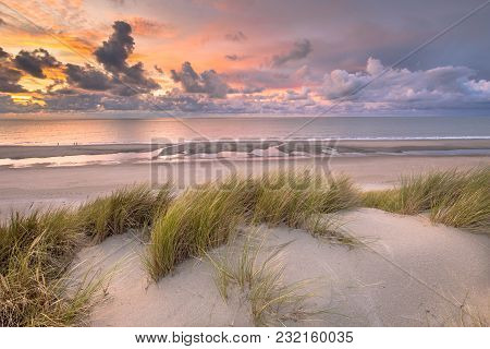 Sunset View From Dune Top Over North Sea And Canal In Zeeland, Netherlands