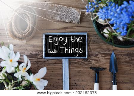 Sign With English Quote Enjoy The Little Things. Sunny Spring Flowers Like Grape Hyacinth And Crocus