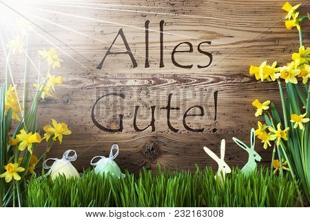 Wooden Background With German Text Alles Gute Means Best Wishes. Easter Decoration Like Easter Eggs