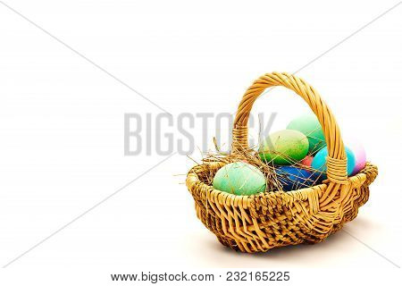 Coloured Easter Eggs In The Basket On White Background