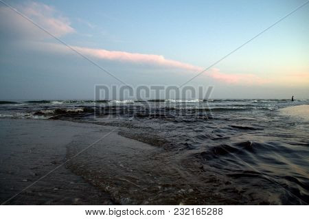 High Tide Water Current Coming In Along The Atlantic Ocean Shoreline In The Evening After Sunset