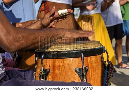 Percussionist Playing Atabaque During Folk Samba Performance On The Streets Of Rio De Janeiro